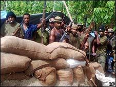 Heavily armed rebels in a jungle camp near Honiara, Solomon Islands (June 2000)