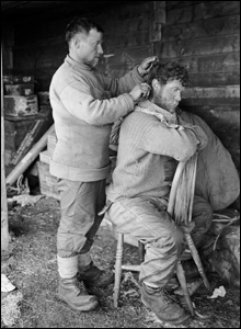 Two members of Captain Scott's expedition team - Anton and Keohane - are captured getting a haircut.