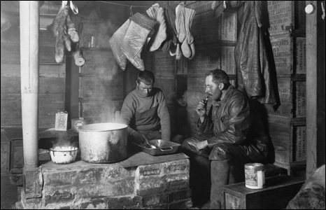 Meares and Dimitri at the blubber stove in the Discovery Hut at Hut Point, 3 November 1911.