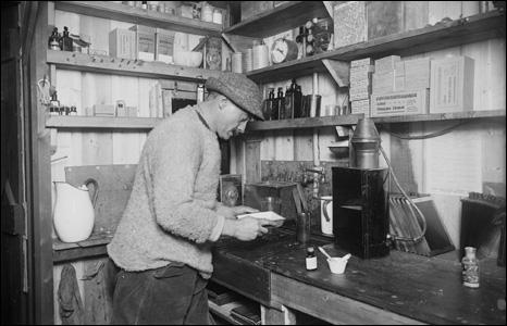 Herbert Ponting at work in the dark room.
