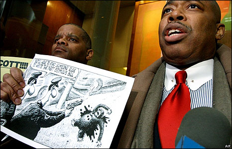Senator holding the New York Post cartoon