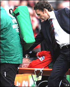Gareth Southgate shows his concer for Didier Digard as the midfielder is stretchered off
