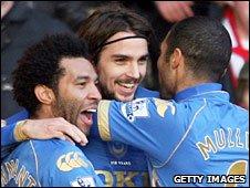 Portsmouth celebrate Nico Kranjcar's opening goal at Stoke