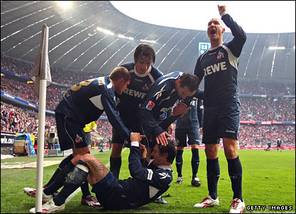 Cologne captain Fabrice Ehret (centre) celebrates with team-mates after scoring in a surprise 2-1 victory against Bayern Munich at the Allianz Arena