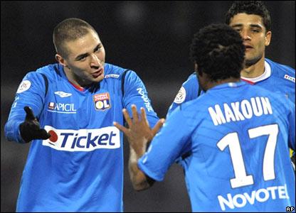 Lyon striker Karim Benzema (left)