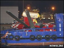 The wreckage of the helicopter arrives in Aberdeen