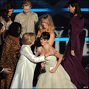 Penelope Cruz is embraced by former Oscar winners