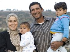 -Mahmoud Issa and his family in olive grove near Jenin in Palestine