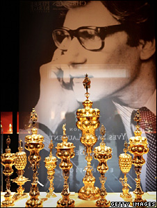 Picture of Yves Saint Laurent behind several Bodendick table fountains