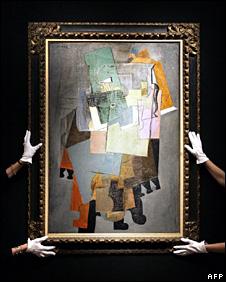 Christie's employees hold Picasso's Instruments de Musique sur un Gueridon