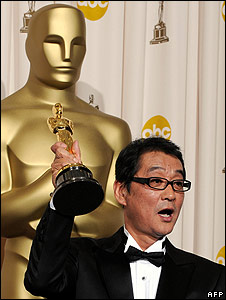 Departures director Yojiro Takita holds his Oscar