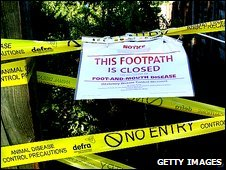 Sign on the gate of a public footpath near a Surrey farm hit by foot-and-mou