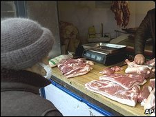 File Picture. Butcher sells pork in Beijing (09/12/08)