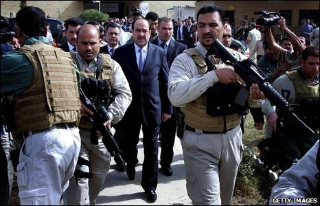 Iraqi Prime Minister Nouri Maliki arrived at the re-opening ceremony surrounded by bodyguards.