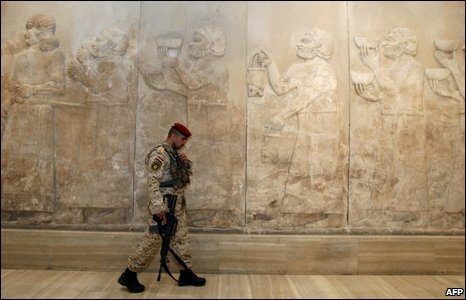 An Iraqi security officer walks through the Assyrian hall