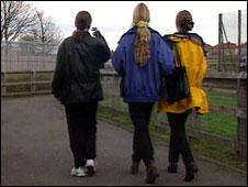teenage girls walking along