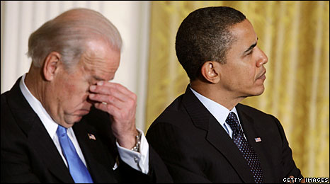 Vice President Joe Biden holds his head as he and President Barack Obama attend a summit to discuss the subject of fiscal responsibility