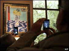 Members of the public take pictures of Matisse's Les Coucous, tapis bleu et rose