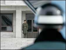 A South Korean soldier (near) stares at a North Korea soldier across their border (file image)