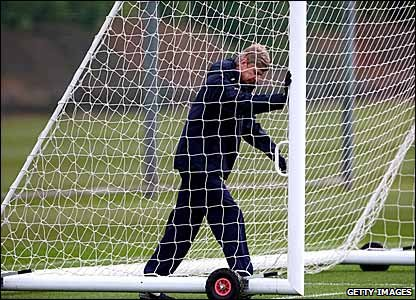 Arsenal manager Arsene Wenger helps set up a training session