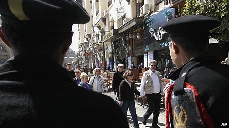 Egyptian police and tourists at the entrance to Khan al-Khalili