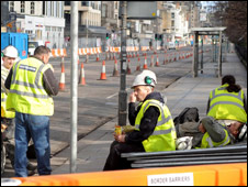 Workers take a break from track laying in Princes Street