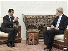Syrian President Bashar al-Assad and US Senator John Kerry