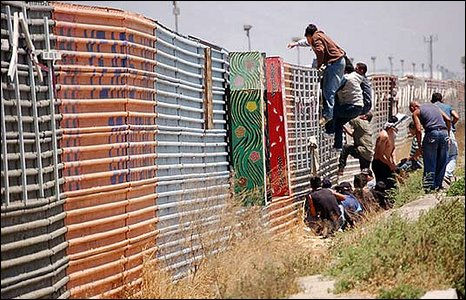 People climb fence dividing US and Mexico