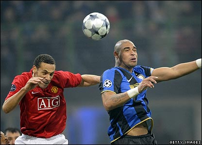 Rio Ferdinand comfortably deals with the danger of Adriano