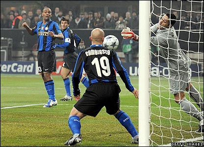 Inter keeper Julio Cesar makes a fabulous save from Cristiano Ronaldo's header