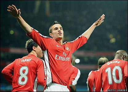 Robin van Persie celebrates putting Arsenal ahead