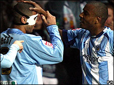 Leon Best (left) celebrates with Clinton Morrison