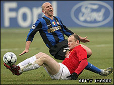 Esteban Cambiasso and Wayne Rooney