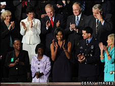 Michelle Obama and other audience members applaud Barack Obama's address to a joint session of Congress, 24 February 2009