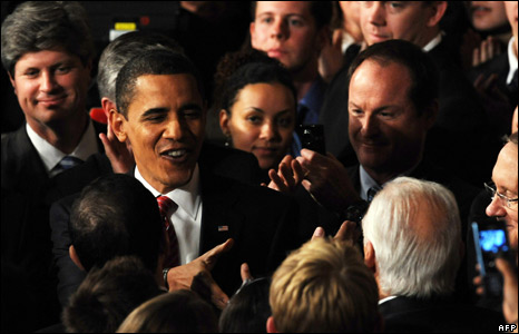 Audience members flock around President Obama
