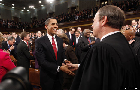 Supreme Court Chief Justice John Roberts (R) greets President Obama