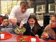 Jamie Oliver serves healthy food to school children