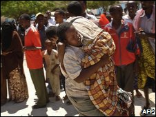 A Somalian boy wounded in a mortar attack in Mogadishu is carried to hospital on 24 February 2009