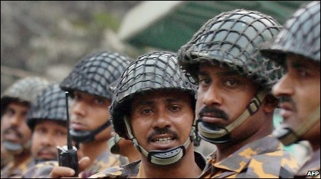 File photo: Bangladesh Rifles soldiers stand guard during a protest rally in Dhaka, December 12, 2006