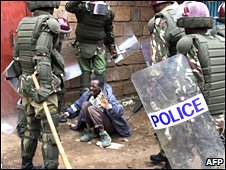 Kenyan police detain a man in Nairobi during post-poll violence