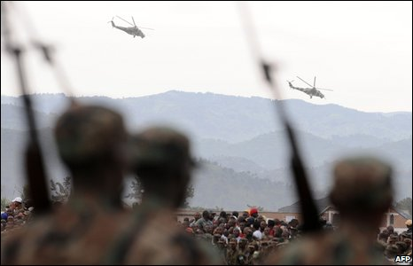 Congolese attack helicopters fly over a ceremony in Goma, eastern DR Congo, on 25 February 2009