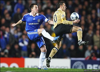 Chelsea skipper John Terry challenges his Juventus counterpart Alessandro Del Piero