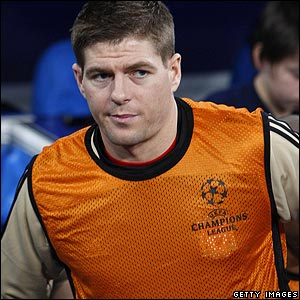 Liverpool's Steven Gerrard watches events unfold from the substitutes bench