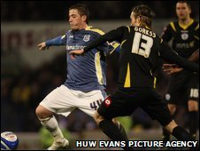 Ross McCormack takes on QPR's Kaspars Gorkss