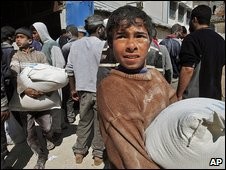 Palestinians collect aid in Gaza
