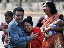 Former hostages react after their release from the Bangladesh Rifles headquarters in Dhaka on 26 February 2009