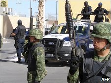 Mexican army soldiers and federal police guard the perimeter around the site where the Interior secretary and members of the federal security cabinet are gathered to discuss the ongoing wave of violence in the border state of Chihuahua