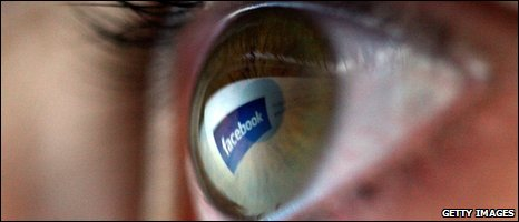 Facebook logo reflected in eyeball, Getty