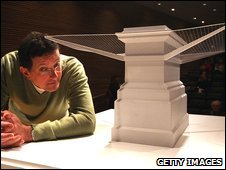 Antony Gormley with a model of his plinth