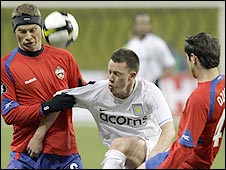 CSKA Moscow duo Aleksei Berezutski (left) and Alan Dzagoev (right) quickly close down Aston Villa's Nicky Shorey (centre)